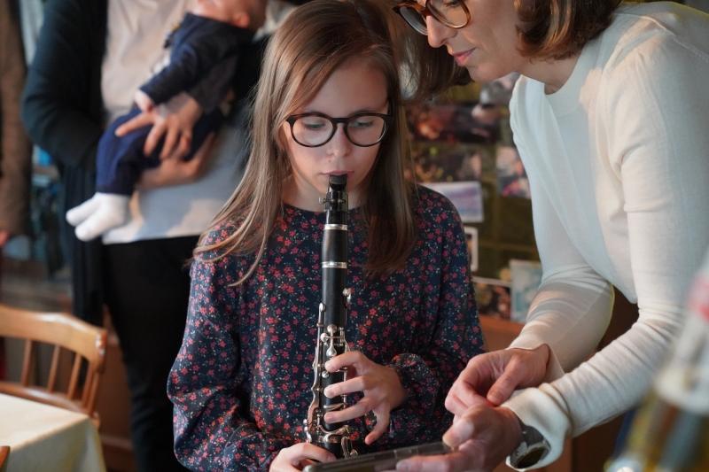 Ava, playing Happy Birthday on  her clarinet