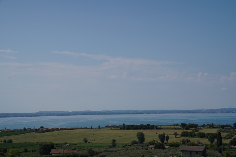 25 km further west, Lazise, near the  south end of lake Garda